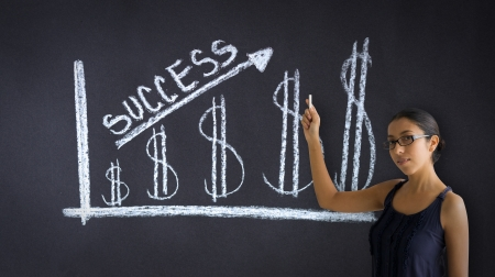Woman pointing at an Success Money Graph llustration. photo
