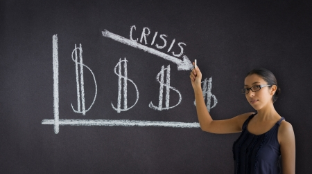 Woman pointing at an Crisis business graph.  photo