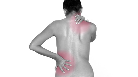 back ache: A woman massaging upper and lower back.