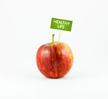 achievment: A red Apple isolated on white background with a Healthy Life sign
