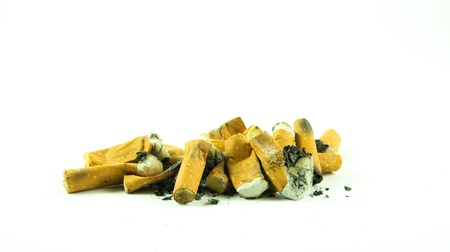 A Pile of Cigarette Butts isolated on white background  Stock Photo - 18704612
