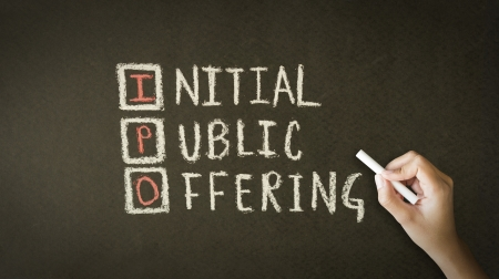 public offering: A person drawing and pointing at a Initial Public Offering Chalk Drawing
