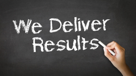 A person drawing and pointing at a We deliver Results Chalk Illustration