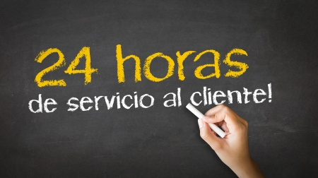 client service: A person drawing and pointing at a 24 hour client Service Chalk Illustration