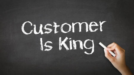 A person drawing and pointing at a Customer is King Chalk Illustration Stok Fotoğraf