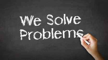 A person drawing and pointing at a We Solve Problems Chalk Illustration Stock fotó