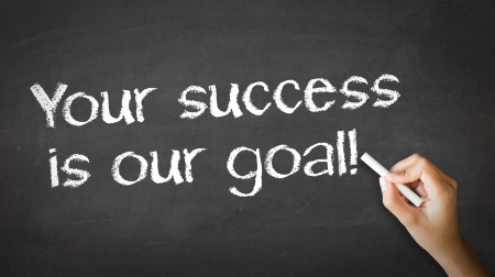 A person drawing and pointing at a Your Success is our goal Chalk Illustration Stock Photo