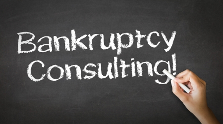 debt management: A person drawing and pointing at a Bankruptcy Consulting Chalk Illustration