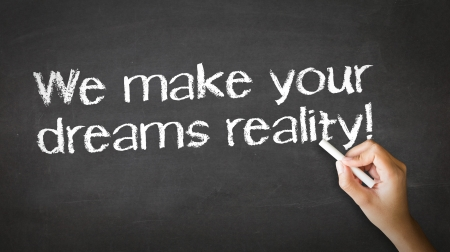 A person drawing and pointing at a We make dreams reality Chalk Illustration Stock Illustration - 20895850