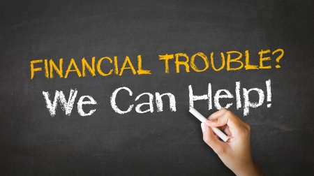 creditors: A person drawing and pointing at a Financial Trouble Chalk Illustration Stock Photo