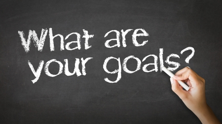 A person drawing and pointing at a What Are your Goals Chalk Illustration illustration