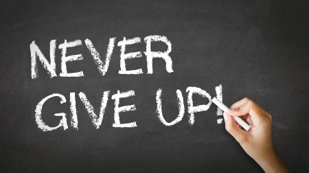 A person drawing and pointing at a Never Give Up Chalk Illustration illustration