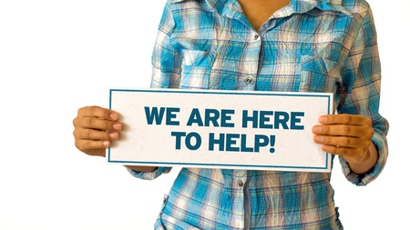 help: A woman holding a We are here to help sign. Stock Photo