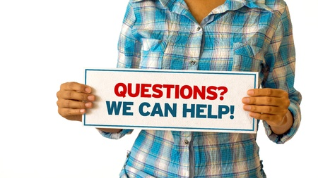 quality questions: A woman holding a Questions, we can help sign.