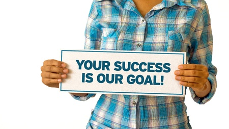 A woman holding a Your Success is our Goal sign. Stock Photo - 21604665
