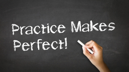 A person drawing and pointing at a Practice Makes Perfect Chalk Illustration Reklamní fotografie - 21604675