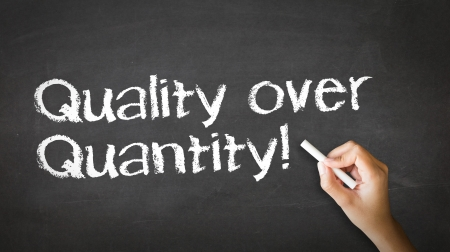 A person drawing and pointing at a Quality over Quantity Chalk Illustration Stock Illustration - 21604722