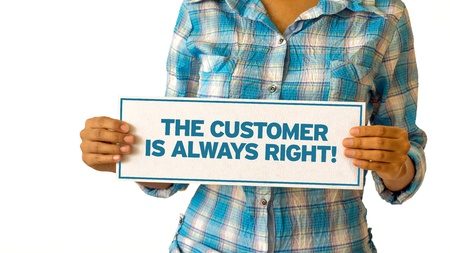 A woman holding a The customer is always right sign. Stock Photo - 21604802
