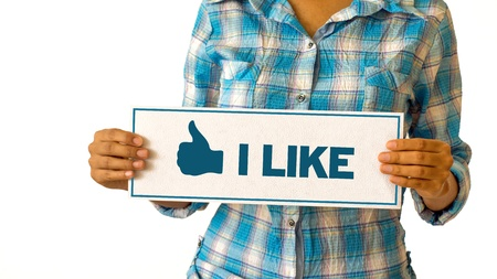A woman holding a I Like Thumbs Up sign. Stock Photo - 21604809