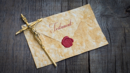 old envelope: A golden crucifix and sealed Envelope of a Testament on wood background
