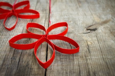 minature: Red Paper Christmas Stars on wooden textured background