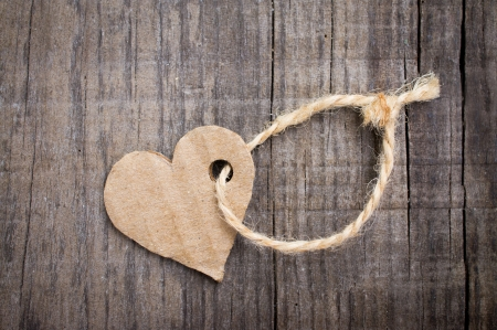 romatic: A Paper Heart Tag on wooden background
