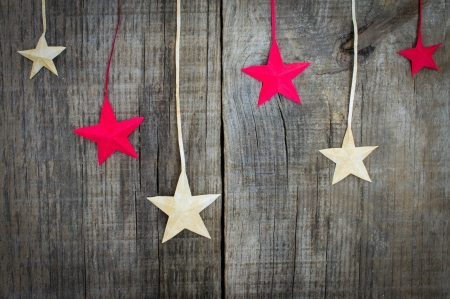 minature: Christmas Star Decoration on wooden textured background Stock Photo