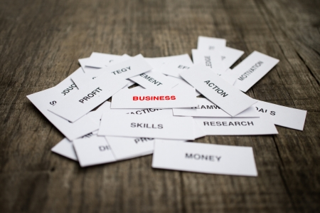 Paper strips with Business Concept related words on wooden background Stock Photo - 22302509