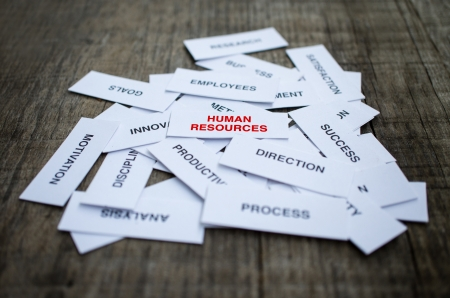 Paper strips with Human Resources related words on wooden background Banco de Imagens