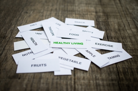 Paper strips with Healthy Living Concept related words on wooden background Stock Photo - 22302515
