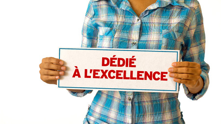 A woman holding a Dedicated To Excellence sign. Stock Photo - 22302526