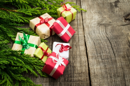 minature: Christmas Decoration with presents on wood textured background.