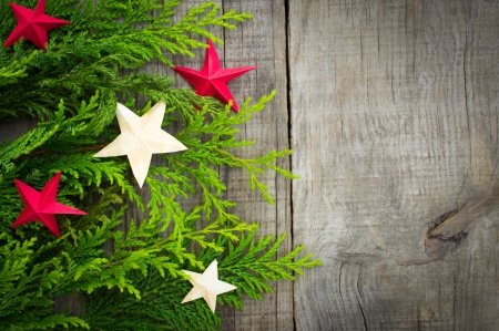 Christmas Decoration concept with stars on wood background Фото со стока
