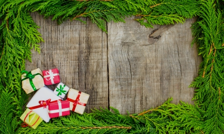 A christmas frame concept with presents on wood background