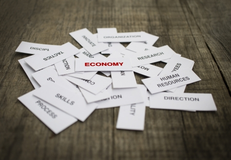 Paper strips with Economy related words on wooden background Stock Photo - 23330203