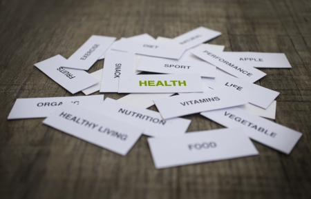 Paper strips with Healthy Concept related words on wooden background