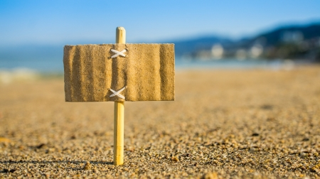 A miniature for sale sign on a tropical beach Stock Photo - 23479027