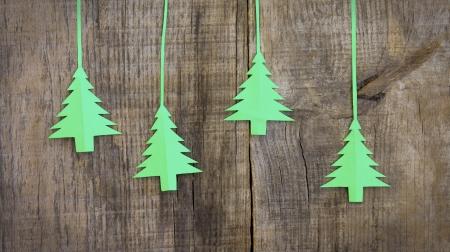 Christmas tree decoration on wood textured background.