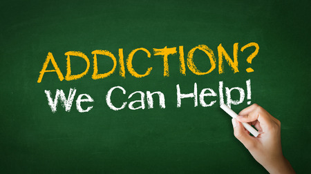 addiction drinking: A person drawing and pointing at a Addiction We can Help Chalk Illustration