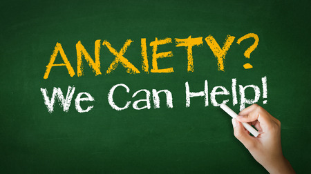 A person drawing and pointing at a Anxiety we can help Chalk Illustration