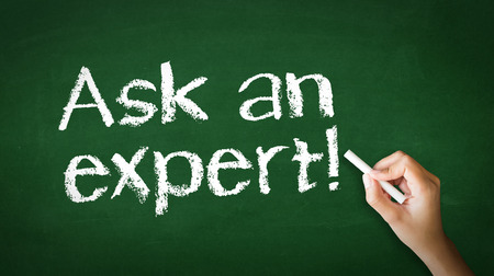 warranty questions: A person drawing and pointing at a Ask an Expert Chalk Illustration Stock Photo