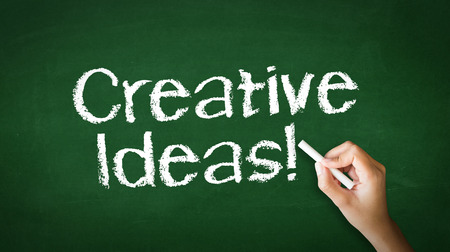 A person drawing and pointing at a Creative ideas Chalk Illustration Stock Photo