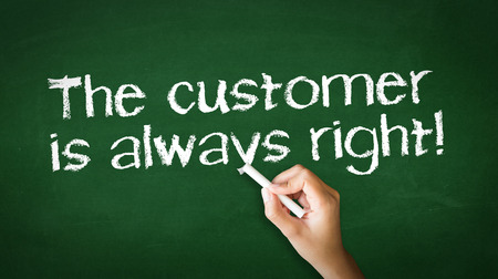A person drawing and pointing at a The customer is always right Chalk Illustration