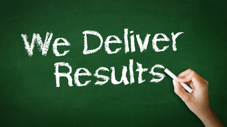 A person drawing and pointing at a We deliver Results Chalk Illustration Фото со стока - 25604205