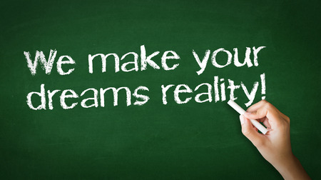 A person drawing and pointing at a We make dreams reality Chalk Illustration