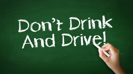 A person drawing and pointing at a Dont Drink And Drive Chalk Illustration