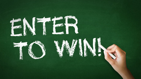 sweepstake: A person drawing and pointing at a Enter to win Chalk Illustration Stock Photo
