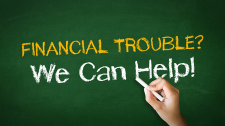 A person drawing and pointing at a Financial Trouble Chalk Illustration Stock Photo