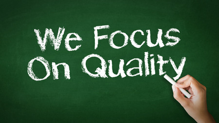 A person drawing and pointing at a We Focus On Quality Chalk Illustration