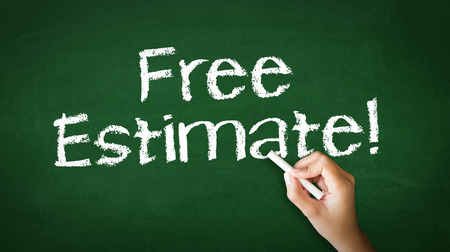 cost estimate: A person drawing and pointing at a Free Estimate Chalk Illustration Stock Photo